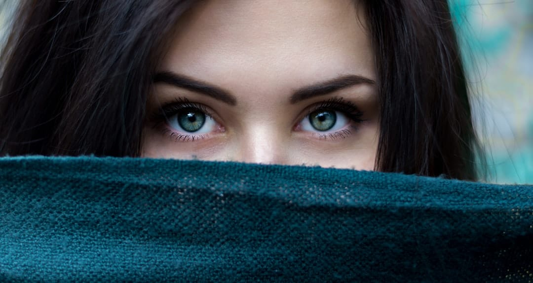 A close up of a woman with blue eyes