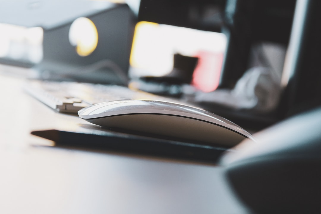 A close up of a computer mouse on a table